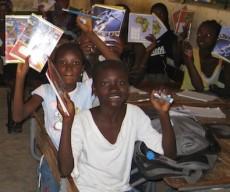 Senegal students holding school supplies