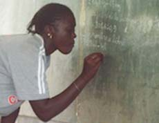 Gril writing on black board